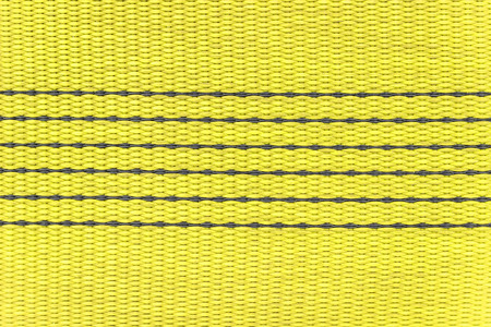 stitched: Wide nylon flat rope stitched with thread yellow Stock Photo
