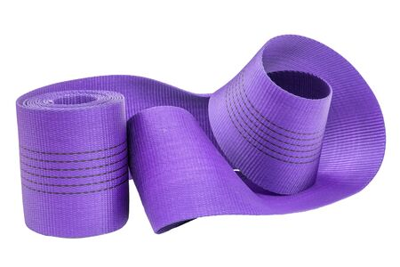 Wide nylon flat rope stitched with thread wound into a roll lilac isolated white background
