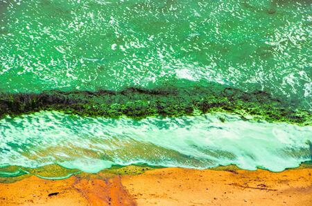 saturation: green surf on sand seaweed waves hdr filter saturation