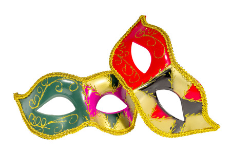 asymmetry: Two Venetian carnival half-mask gold red green black pink asymmetry pattern isolated white background Stock Photo