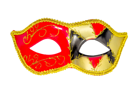 Venetian Carnival Mask red yellow black patterned asymmetrical coloring frontal picture isolated white background Stock Photo