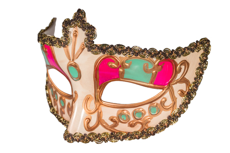 curlicues: Carnival mask gold-painted curlicues decoration pink green inserts half mask isolated white background side view