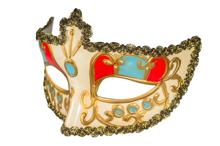 curlicues: Carnival mask gold-painted curlicues decoration blue and red inserts half mask isolated white background side view