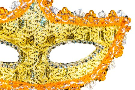 venician: Golden carnival mask isolated on white background fabric bow front view part close-up Stock Photo