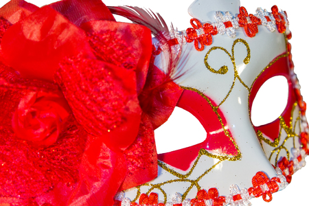 carnival border: Red carnival mask bow decoration flowers border isolated white background side view cut