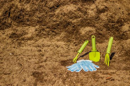 black soil: Garden tools  green gloves  background  black soil