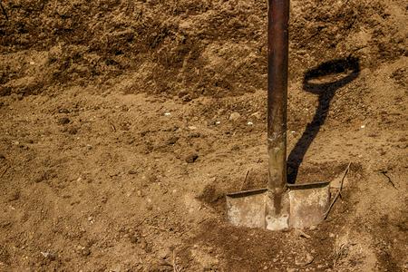 black soil: Shovel in black soil Stock Photo