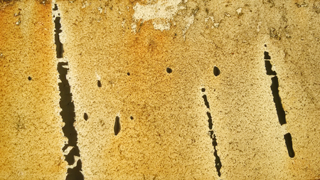 dotted line: Beige brown rough surface with irregular black stripes dotted line Stock Photo