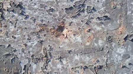 peeling paint: Gray peeling paint on metal
