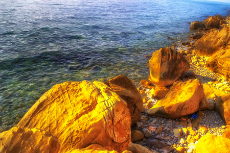 Rocky coast  sea coast Sochi Krasnodar region Russia transparent water bright sunlight Stock Photo