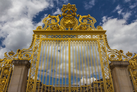 Golden gate in Versailles Palace Stock Photo