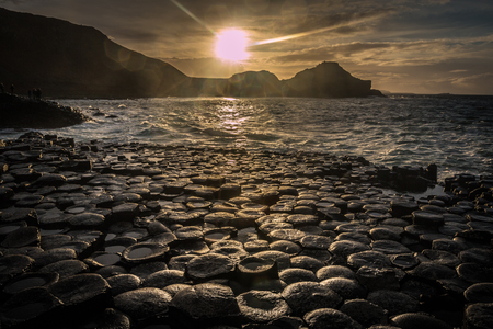 northern ireland: Nice sunset view on Giants Causeway in Northern Ireland Stock Photo