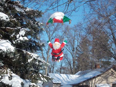 parachuting: Parachuting Santa Stock Photo