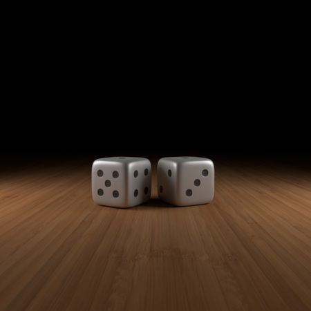 Two dice on wood with black fading in the back