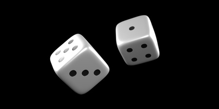 Dice mid throw with a black background Stock Photo