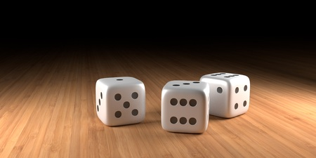 Three dice on wood with black in the background