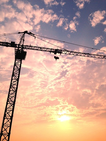 construction: Before sunset and tower crane Stock Photo