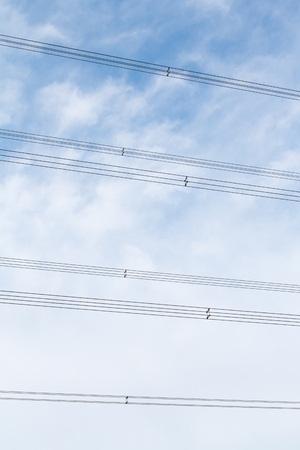 High voltage cable on the sky background