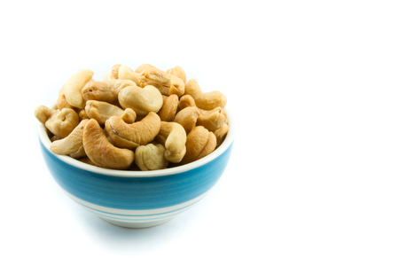 Color bowl with cashew nuts on white background Archivio Fotografico
