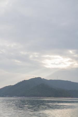 Mountain landscape and river foreground in rockfill dam of Kanchanaburi province, Thailand Archivio Fotografico