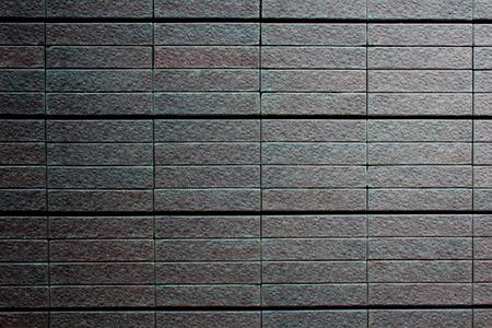 Closeup wall tiles of exterior building,Background texture