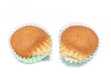 Close up over the mold paper of homemade banana muffin on white background