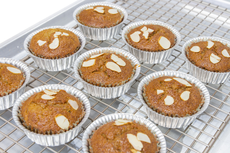 Closeup a homemade banana muffins and chill on an aluminum tray after baking in the oven