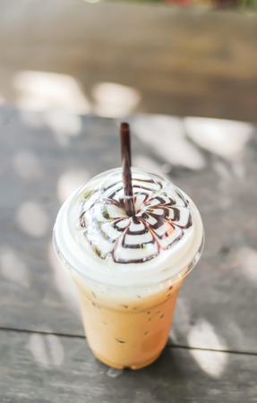 Closeup Iced Latte with foamed milk on top
