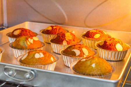 Closeup banana muffins baking in the hot oven