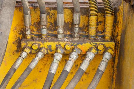 Closeup excavator pressure pipes system