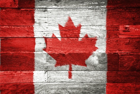 canada flag painted on old wood background photo
