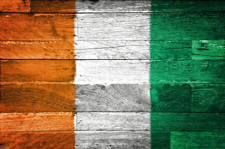 cote d'ivoire: Cote d Ivoire flag painted on old wood background Stock Photo