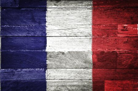 commonwealth: france flag painted on old wood background