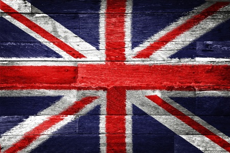 grunge union jack: Great britain flag painted on old wood background