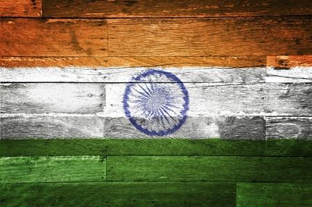 india flag painted on old wood background photo