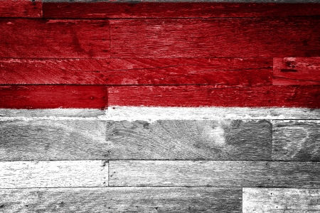 indonesia flag painted on old wood background Stock Photo - 11698183