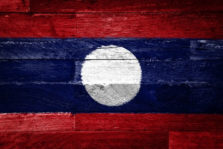 laos flag painted on old wood background photo