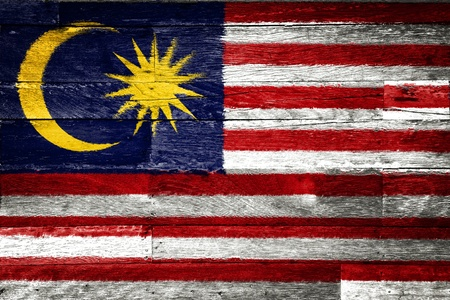 malaysia flag painted on old wood background Imagens - 11698174