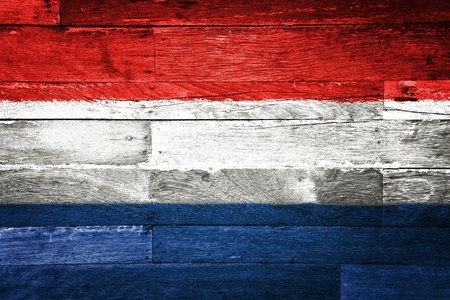 holland: netherlands flag painted on old wood background Stock Photo