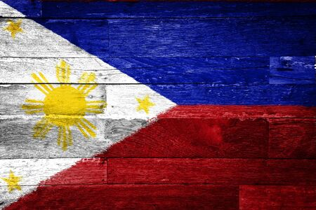 filipino: philippines flag painted on old wood background Stock Photo