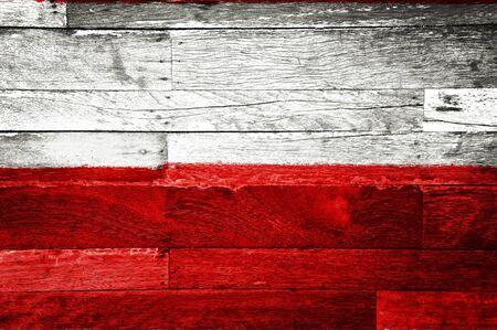 poland flag painted on old wood background photo