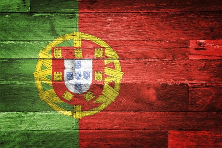 portugal flag painted on old wood background photo