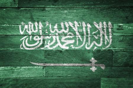 Saudi Arabia flag painted on old wood background photo