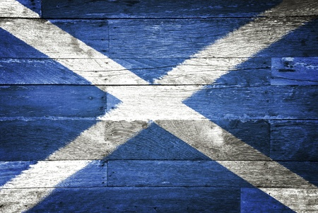 scotland flag painted on old wood background photo