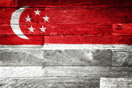 singapore flag painted on old wood background