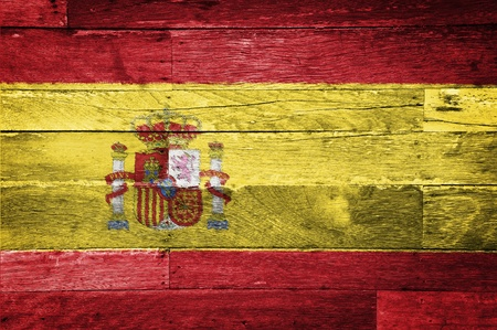 spain flag painted on old wood background Stock Photo - 11698181