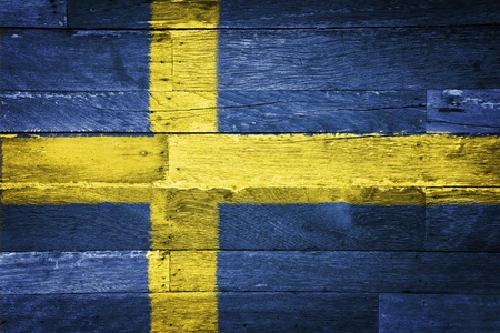 watery: sweden flag painted on old wood background Stock Photo