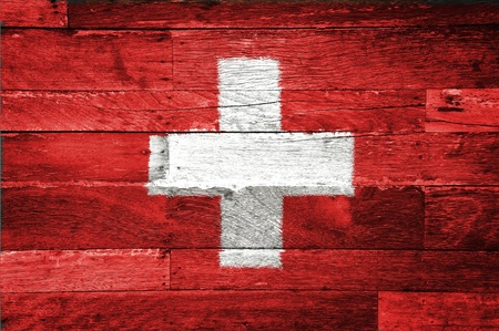 swiss flag: switzerland flag painted on old wood background Stock Photo