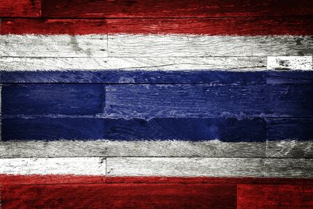 thai language: thailand flag painted on old wood background