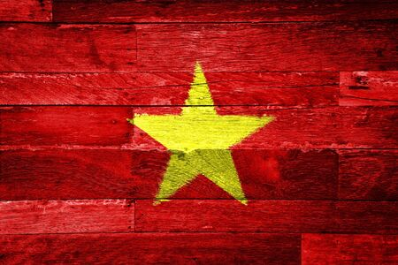 vietnam flag painted on old wood background photo